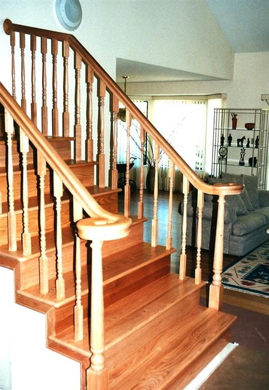 New wood handrail and new solid wood treads after carpet removal for a stair in Orinda.
