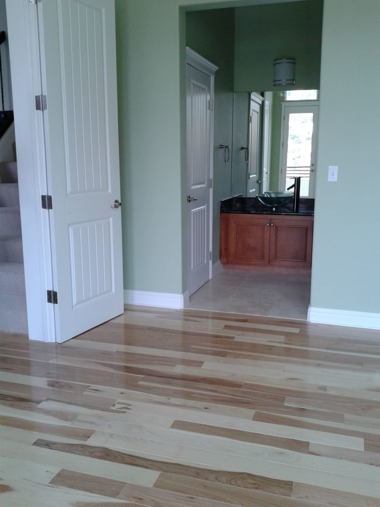 Installed pre-finished engineered floor after carpet removal in Oakland.