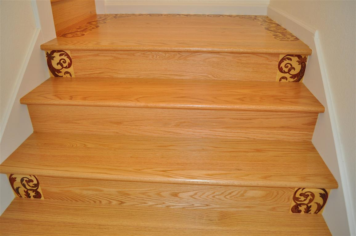 Installed solid wood stair treads and risers with decorative medallions, South San Francisco.