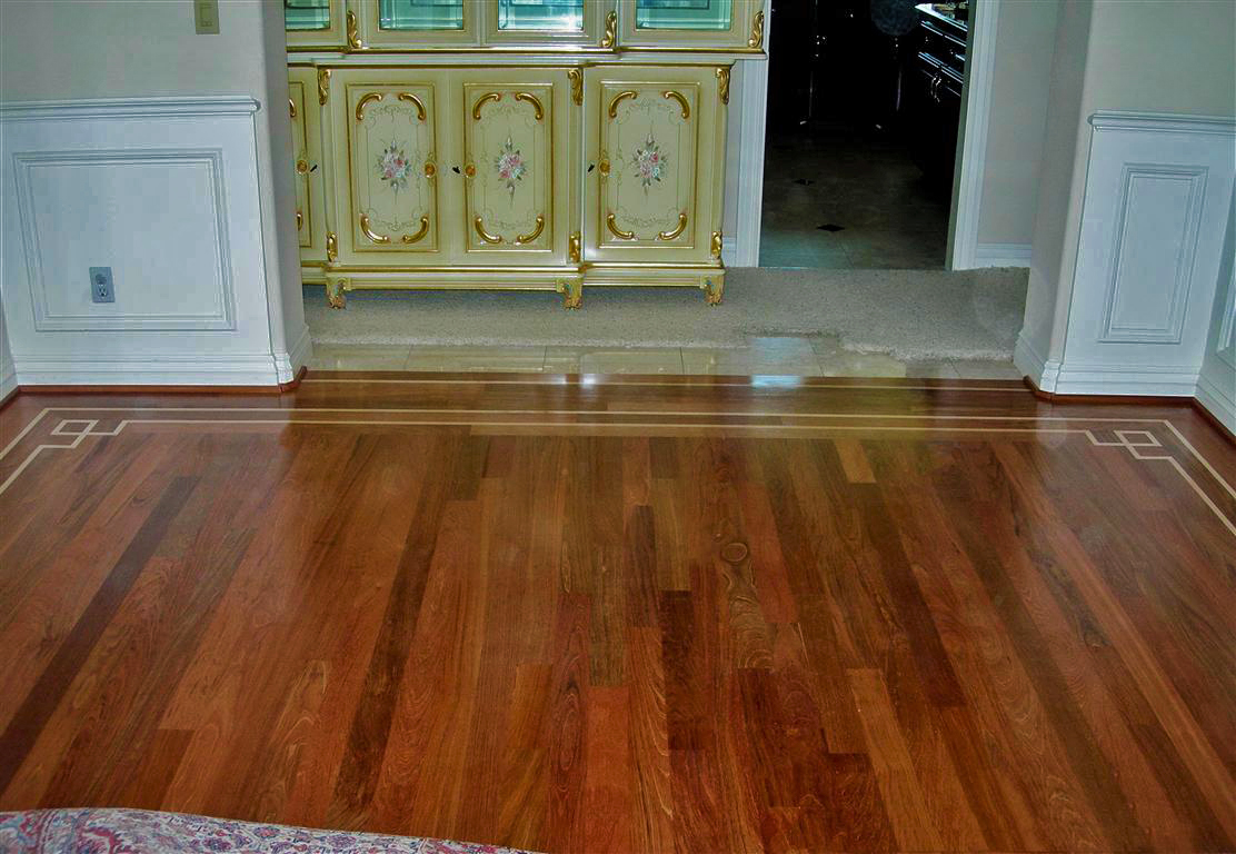 New solid hardwood floor installed on plywood subfloor with decorative borders. San Francisco.