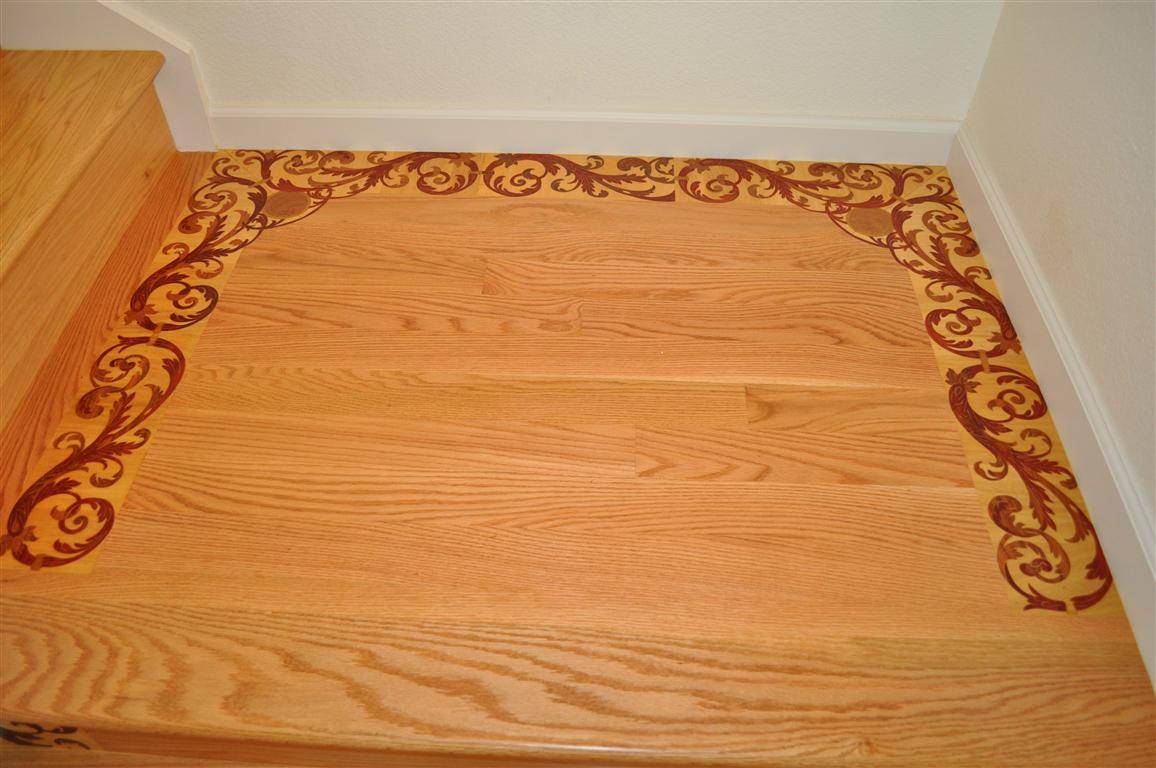 Stair solid wood landing with decorative medallions. South San Francisco.