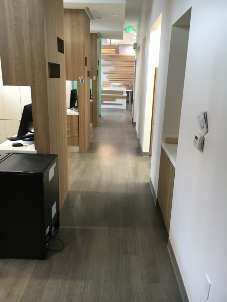 Dental Office in San Francisco with a new luxury vinyl plank flooring installed on concrete subfloor.