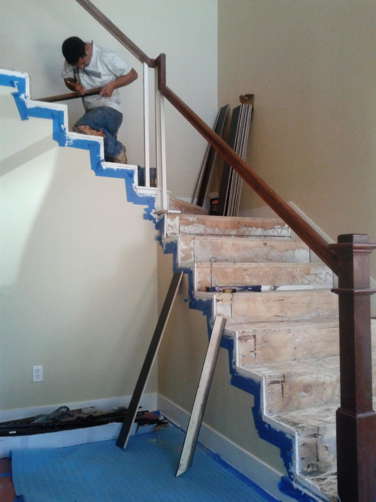 Remodeling of stair in process: after removal of old carpet and planned laminate treads, metal spindles and new handrail install. Livermore.