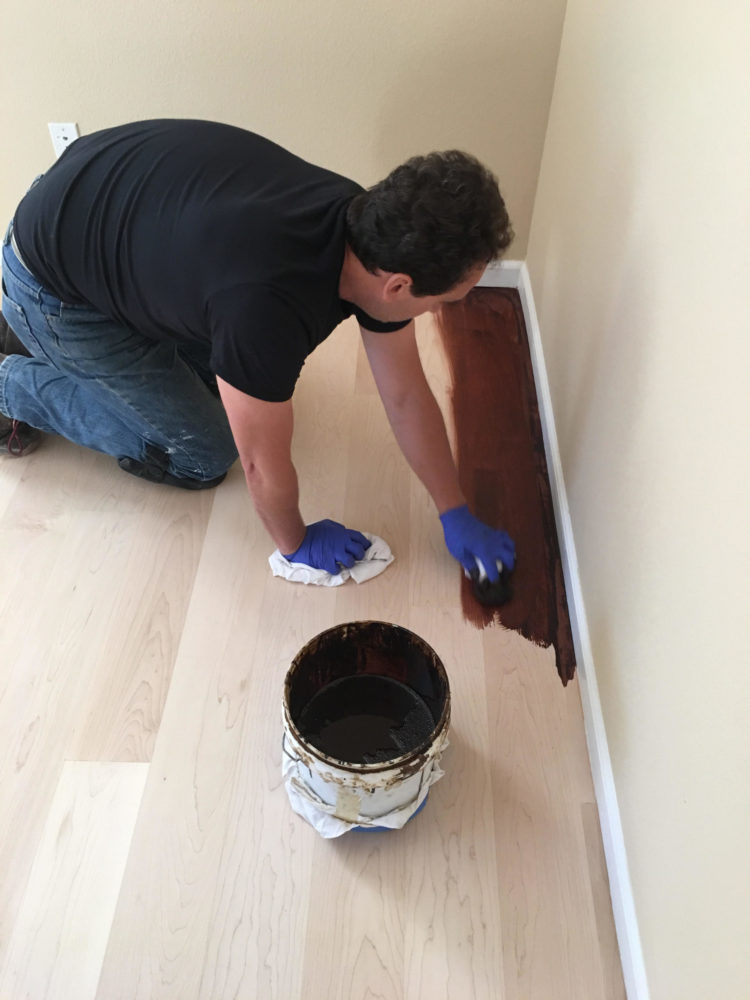 Process of dark staining on a newly installed and sanded hardwood floor in San Francisco.