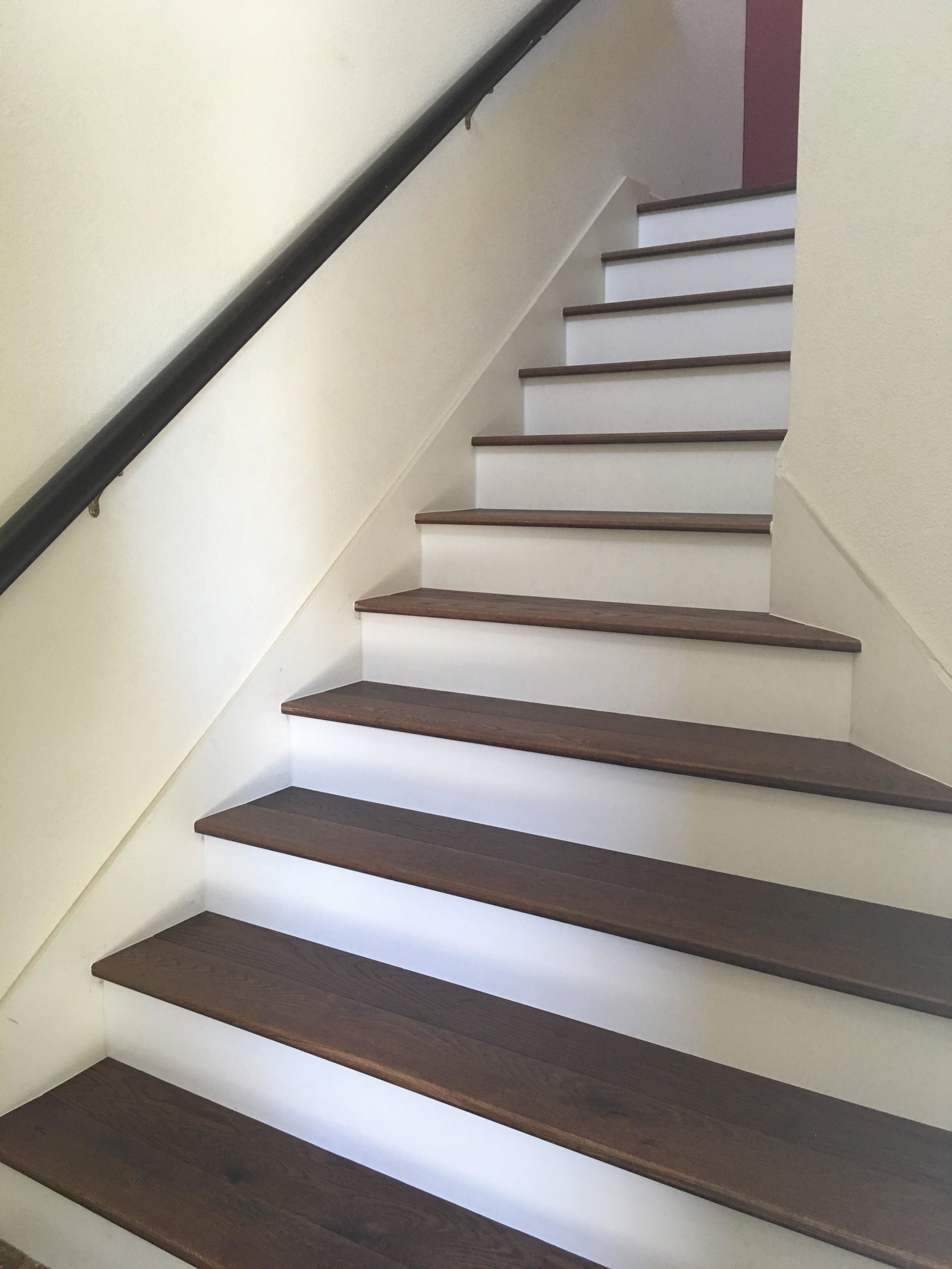 Remodeled stair with new solid wood treads installed in Oakland.