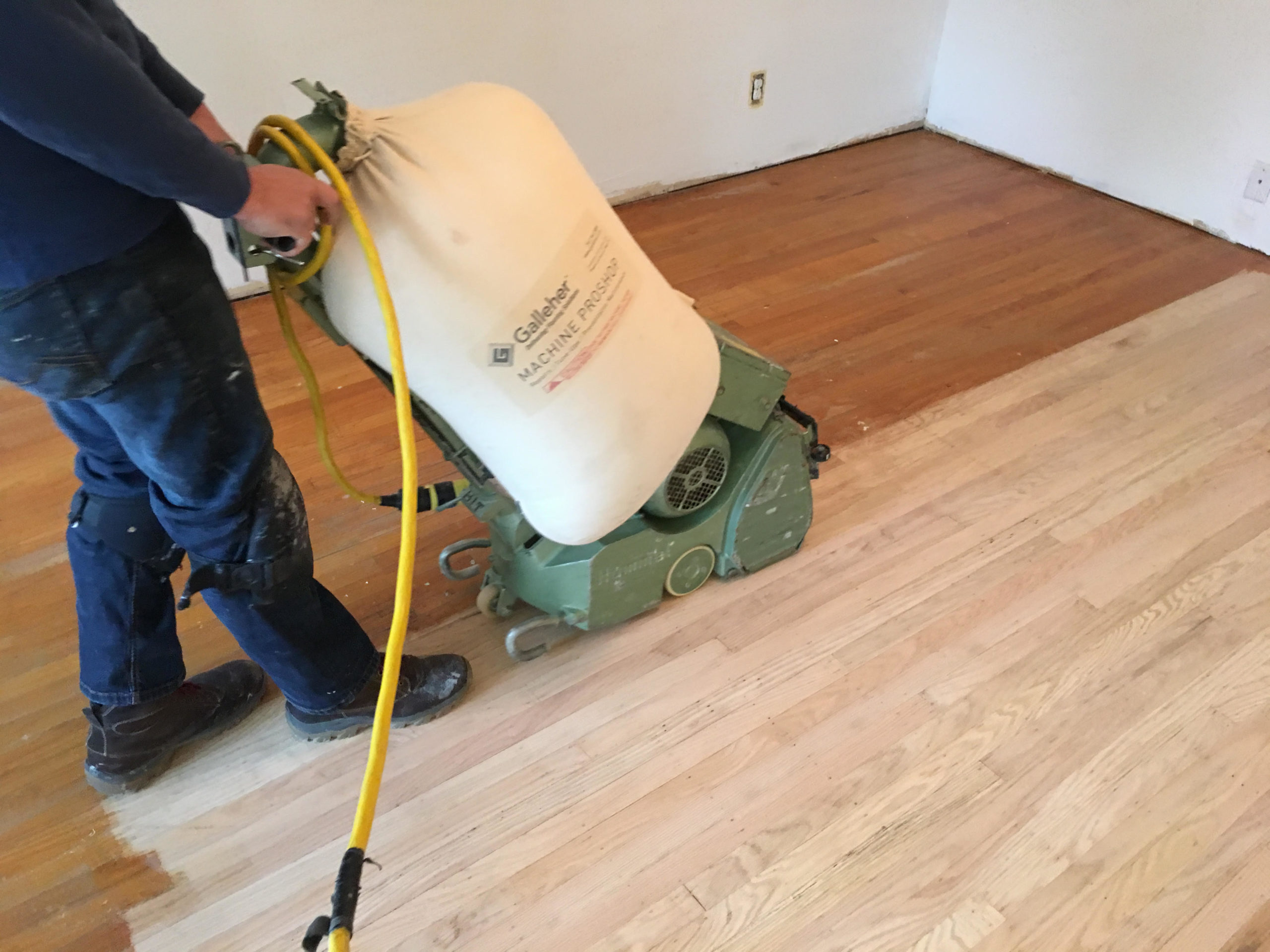 Process of refinishing solid wood floor in San Francisco.