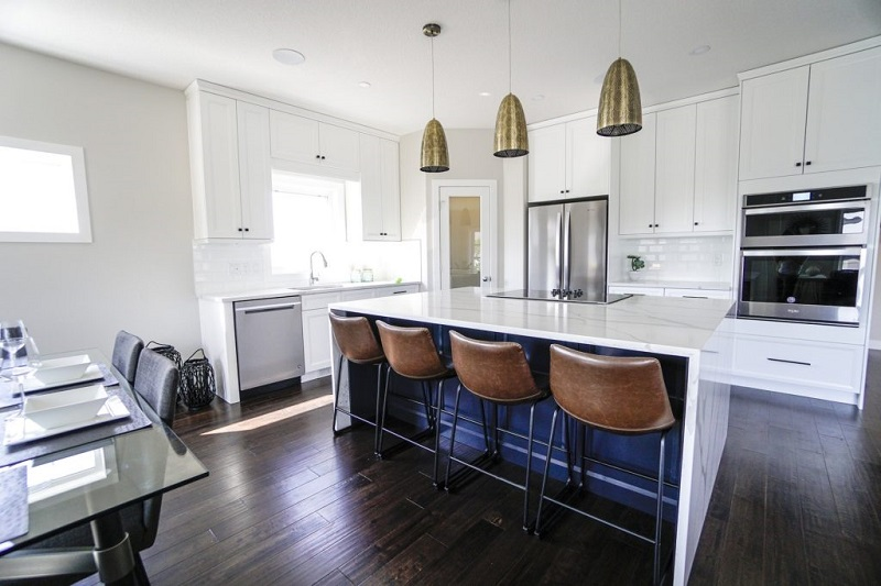 White Kitchen with Dark Brown Hardwood Floors